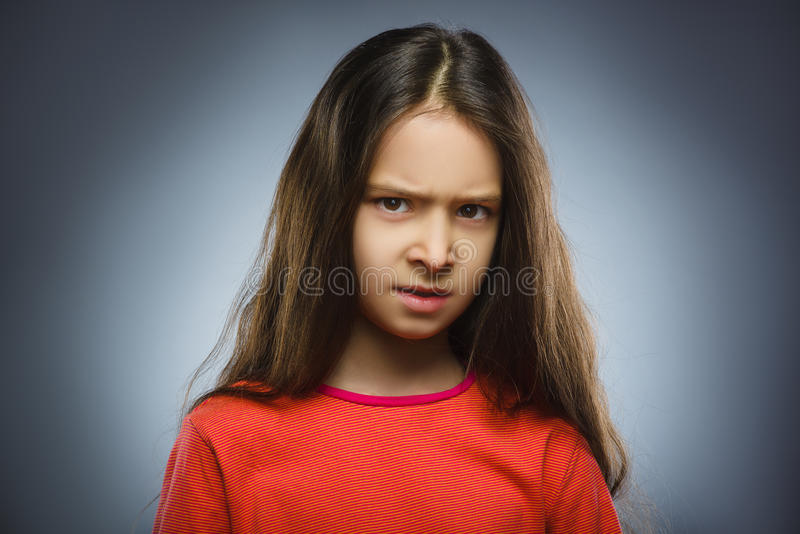 Angry girl isolated on gray background. stock photography