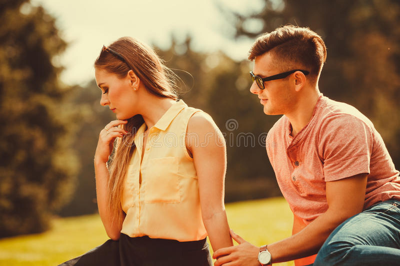 Angry girl rejects her boyfriend. stock image