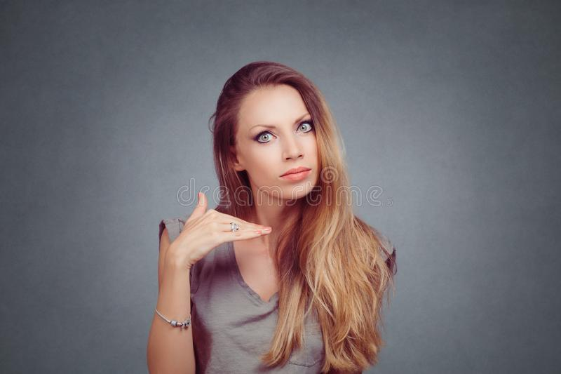 Angry woman showing cut it out stop it hand gesture royalty free stock photo