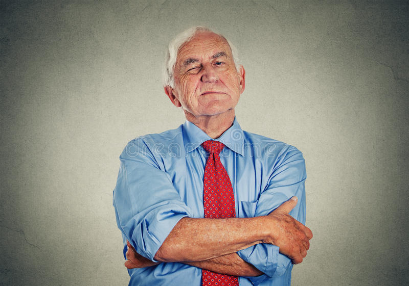 Angry grumpy off senior mature man. Portrait of unhappy grumpy off senior mature man isolated on gray wall background. Negative human emotions, face expression stock images
