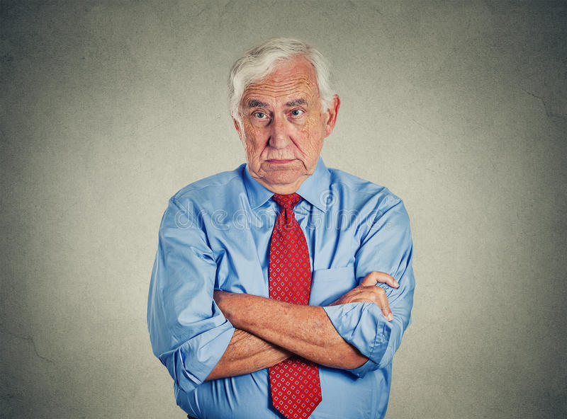 Angry grumpy off senior mature man. Portrait of unhappy grumpy off senior mature man isolated on gray wall background. Negative human emotions, face expression stock photos