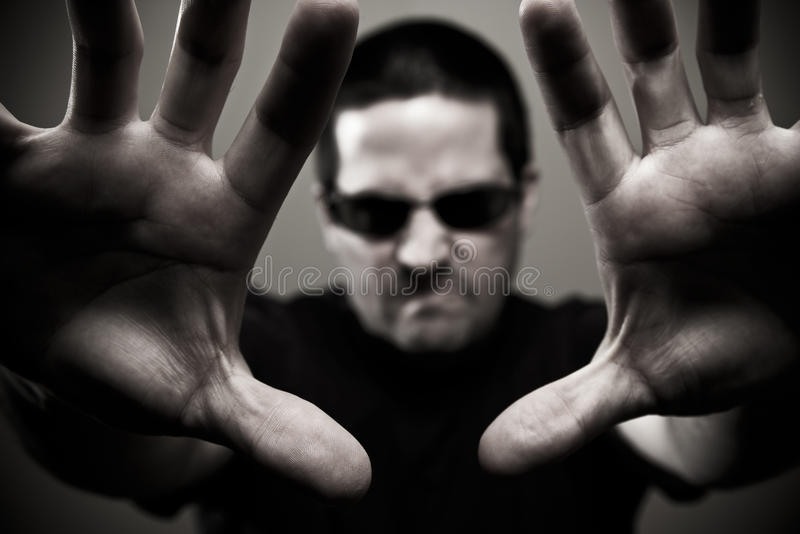 Download Angry Guard Reaches Forward Stock Image - Image: 29378735