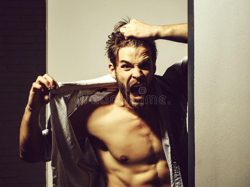 Angry man shows muscle torso stock photos