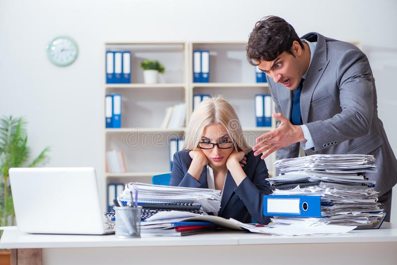 The angry irate boss yelling and shouting at his secretary employee royalty free stock photos