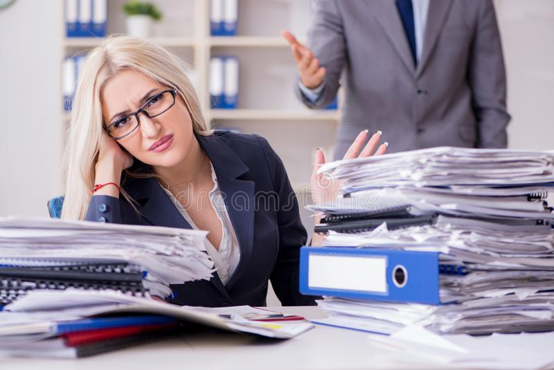 The angry irate boss yelling and shouting at his secretary employee stock photos
