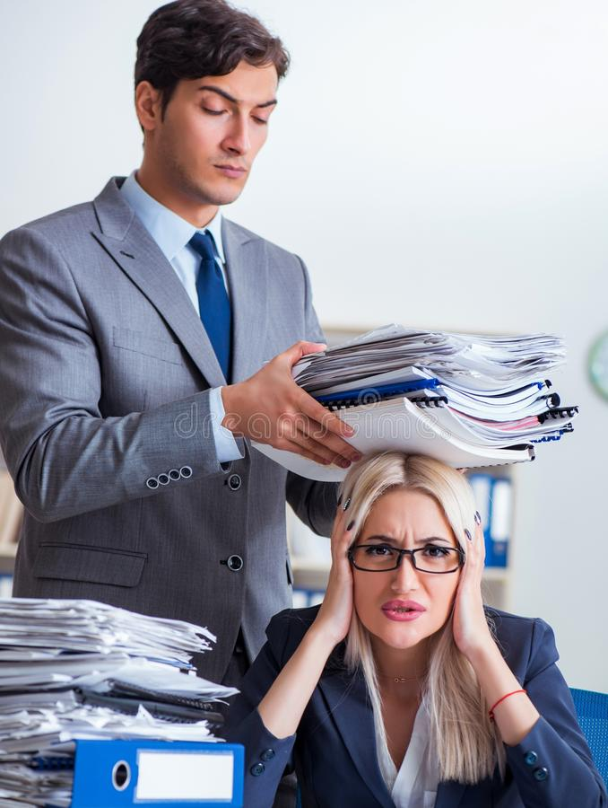 Angry irate boss yelling and shouting at his secretary employee stock photos