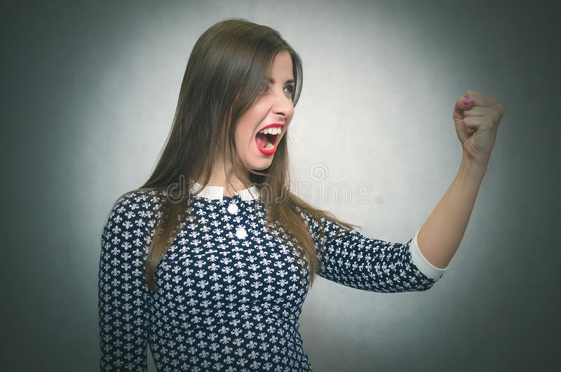 Angry irritated woman. Demanding dissatisfied boss. royalty free stock image