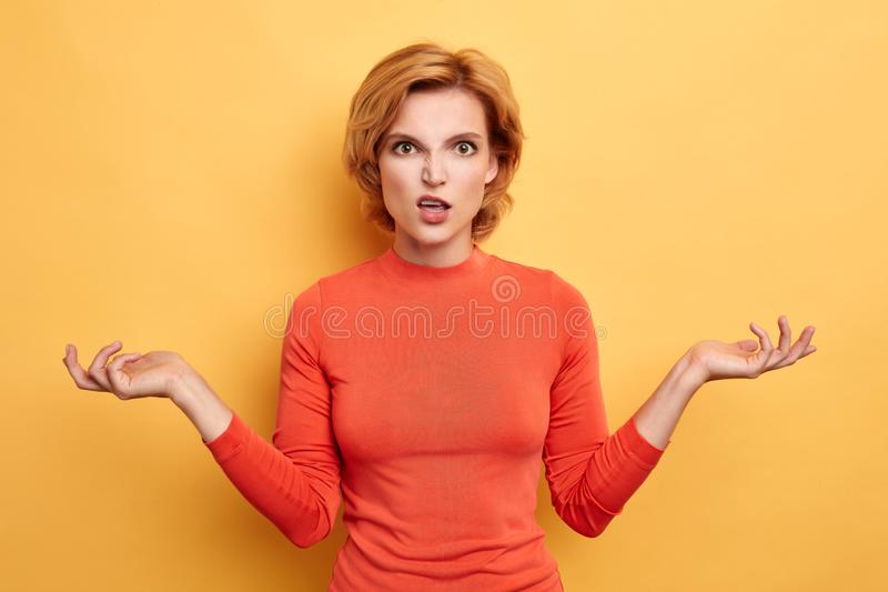 Angry irritated woman with hands raised having an argument with somebody royalty free stock photography