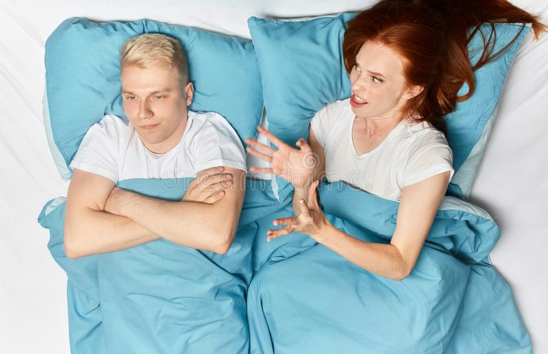 Angry irritated woman scolding her husband stock image