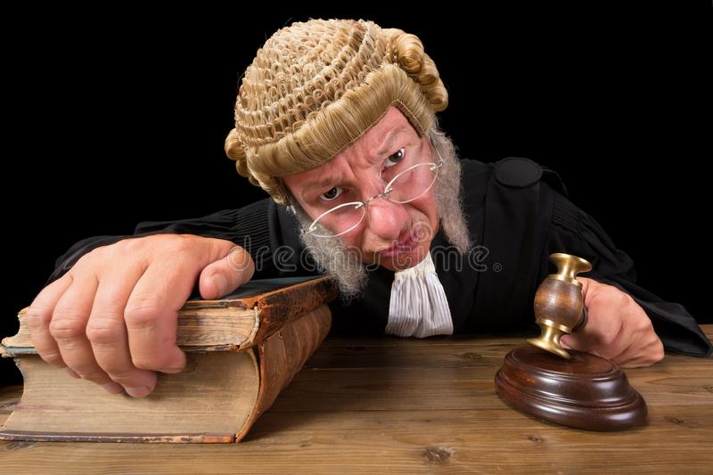 Angry Judge. In extreme wide angle closeup with hammer and wig
