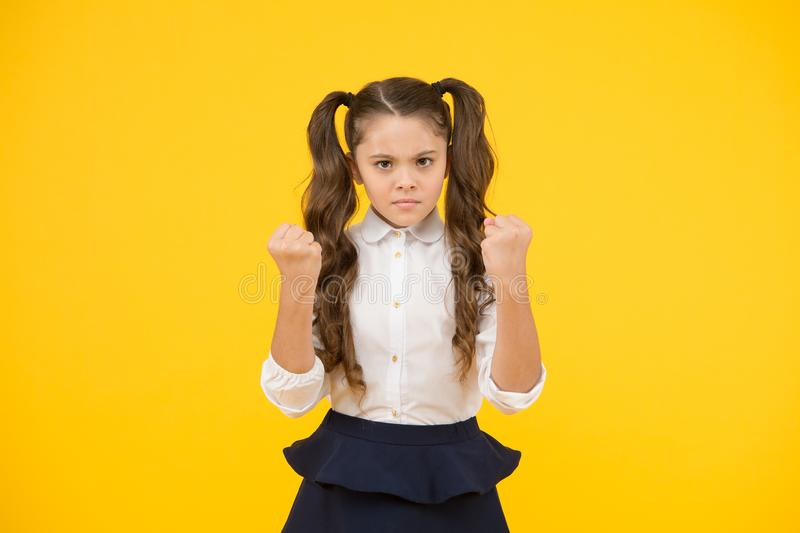 Angry kid. Adorable schoolgirl. Schoolgirl pupil long hair cute ponytails hairstyle. Efficiency studying. Emotional stock images