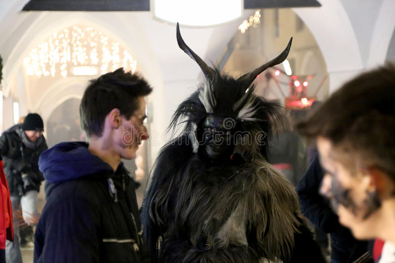Angry Krampus. Brixen/Bressanone, South Tyrol, Italy - December 05, 2013: A traditional parade of the Krampus, beast-like creatures march through the historic royalty free stock photo