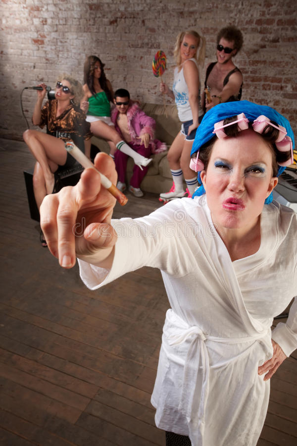 Angry Lady in Bathrobe. Crashing a 1970s Disco Music Party royalty free stock photos