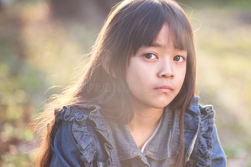 Angry little asian girl stock photo