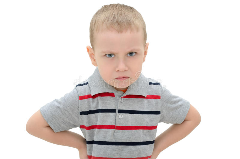 Angry little boy isolated on white background.  royalty free stock image