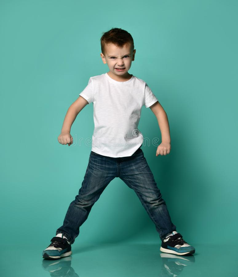 Angry little boy looks straight to camera stock photo