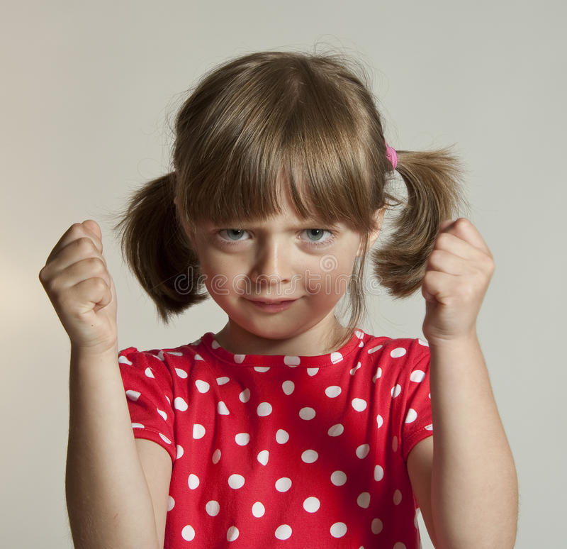 Angry little girl royalty free stock photos