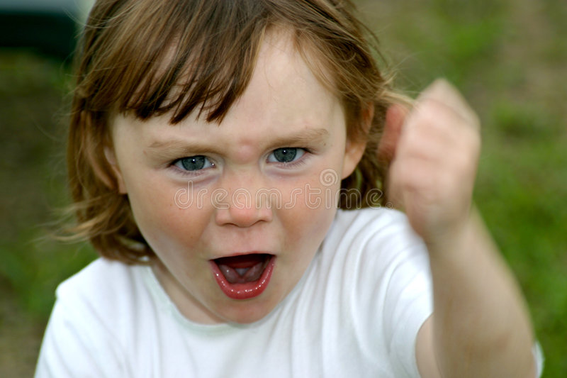 Angry little girl stock image