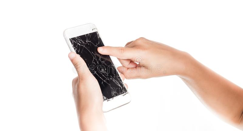 Angry little girl holding a smartphone with broken screen stock photo