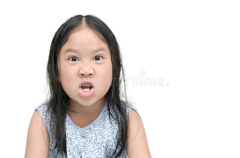 The angry little girl isolated on a white royalty free stock image