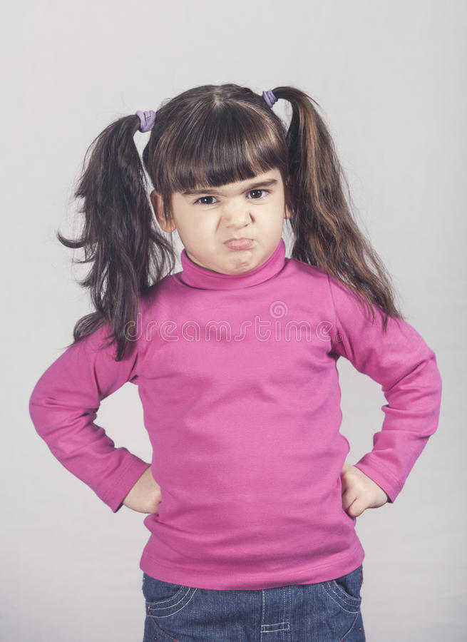 Angry little girl stock photos