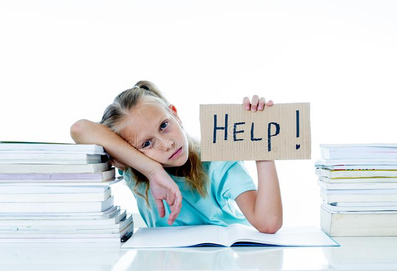 Angry little girl with a negative attitude towards studies and school having too many homework asking for help in children stock photo