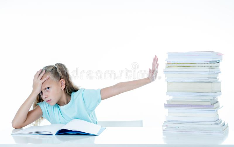 Angry little girl with a negative attitude towards studies and school after studying too much and having too many homework in stock images