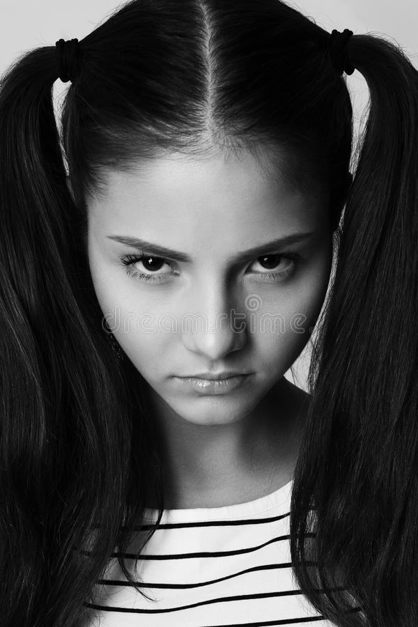 Angry little girl with pigtails fashion model upset. Angry little girl fashion model with pigtails stock photography