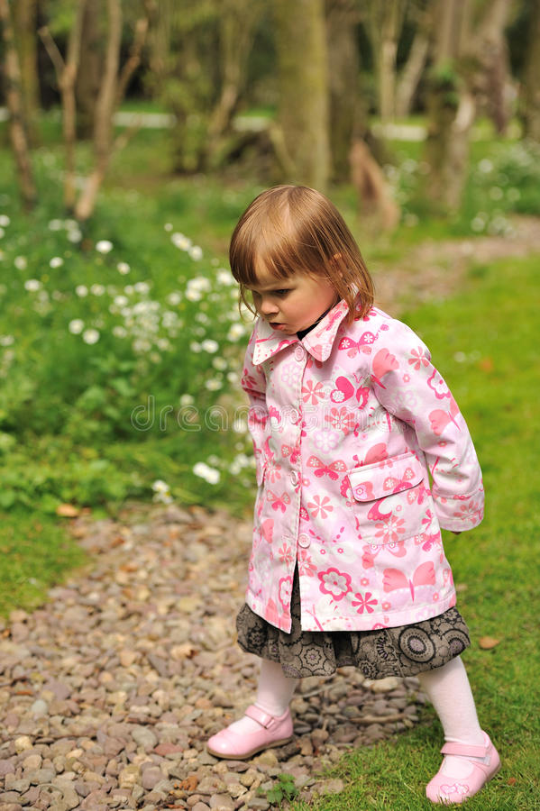 Angry. An angry little girl in a pink coat stock photography