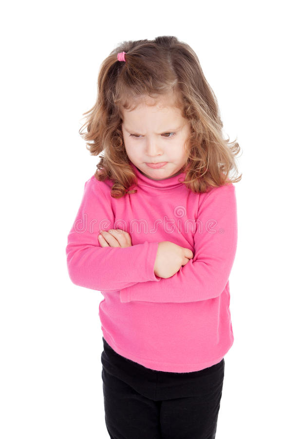 Angry little girl in pink royalty free stock images