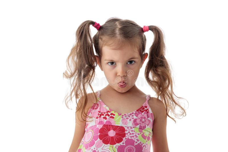 Angry little girl portrait. Naughty beautiful lady royalty free stock photo