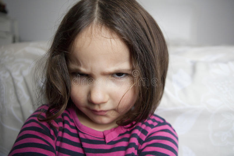 Angry little girl stock image