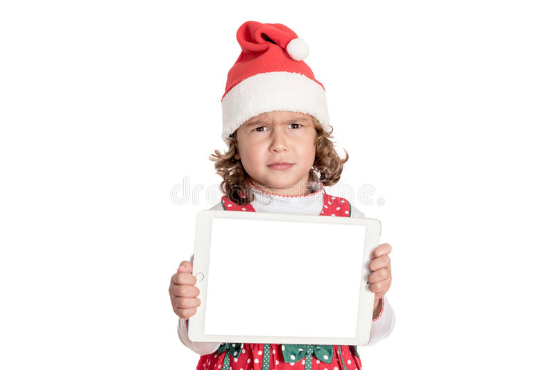 Angry little Santa. Portrait of angry little Santa holding blank screen tablet pc,isolated on white background stock photography