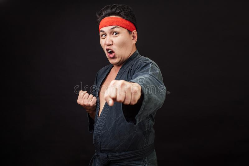 Angry, mad, furious man kicking with somebody. isolated on black backgroud stock photography