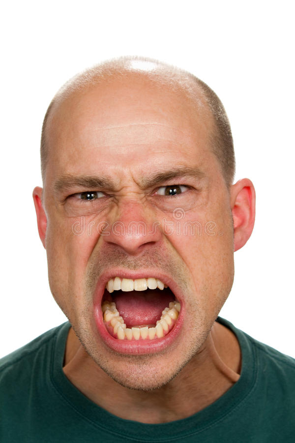 Angry Mad Man. Angry and mad man screams with his mouth wide open showing his rage stock photography