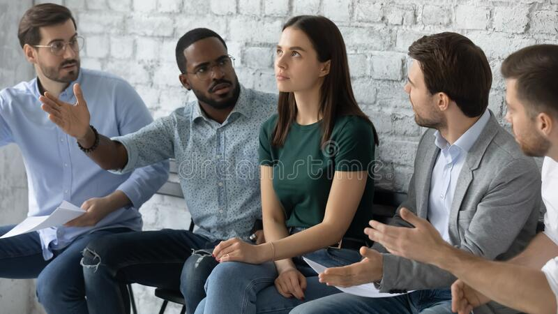 Angry male candidates argue with female applicant before interview. Angry diverse multiethnic applicants argue with confident female before recruitment talk, mad stock images