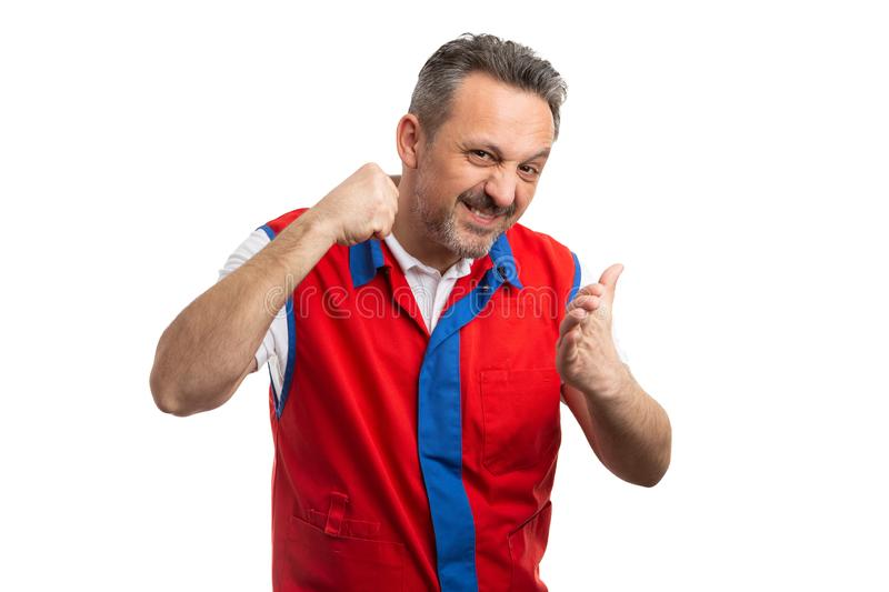 Supermarket employee starting fight with intimidating gesture. Angry male supermarket or hypermarket employee starting with intimidating gesture made by using stock image