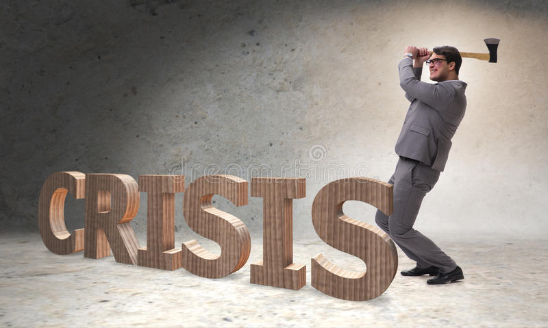The angry man with axe axing the crisis word. Angry man with axe axing the crisis word royalty free stock photo