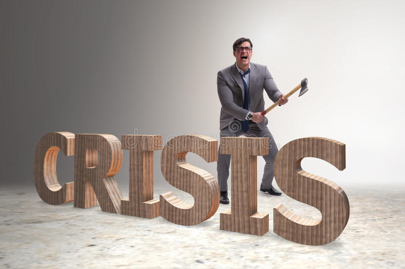 The angry man with axe axing the crisis word. Angry man with axe axing the crisis word royalty free stock photography