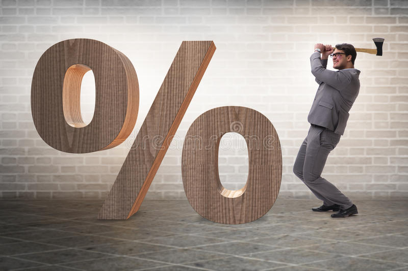 The angry man with axe axing the percentage sign. Angry man with axe axing the percentage sign stock photo