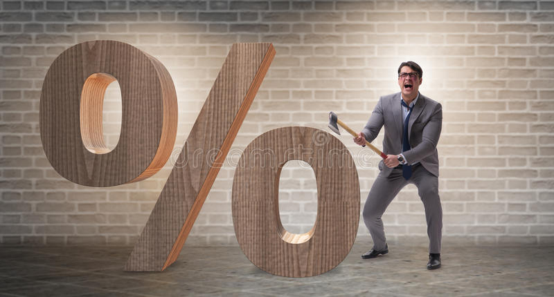 The angry man with axe axing the percentage sign. Angry man with axe axing the percentage sign stock images