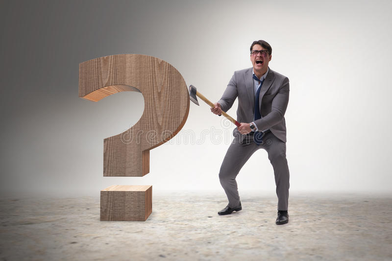 The angry man with axe axing the question mark. Angry man with axe axing the question mark stock photo