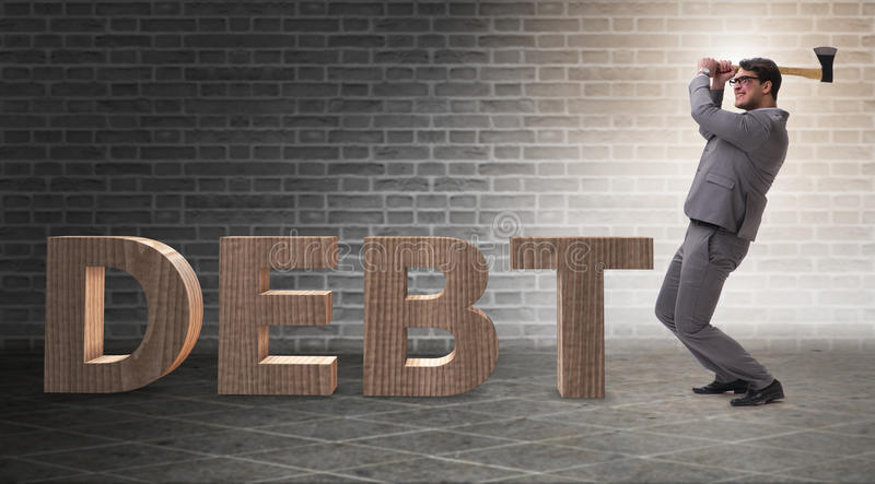 The angry man with axe axing the word debt. Angry man with axe axing the word debt stock photo