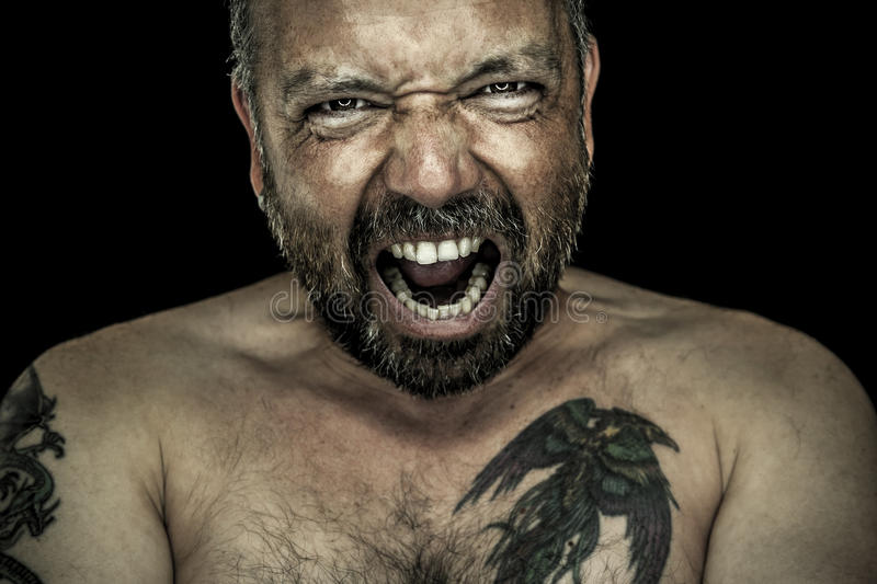 Angry man with beard royalty free stock photography