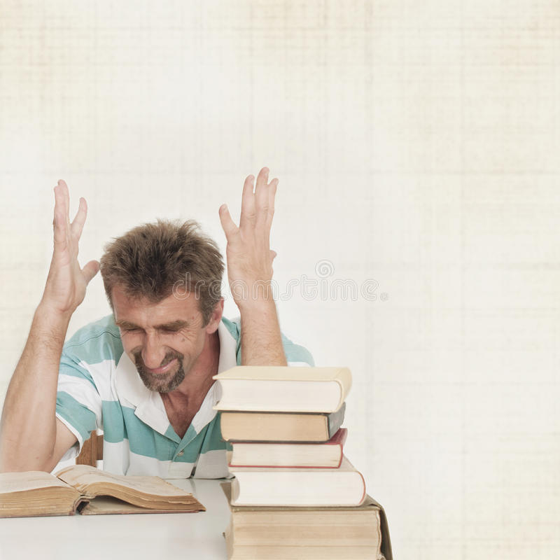 Angry man and books stock photography