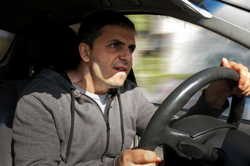 Angry man drives a vehicle