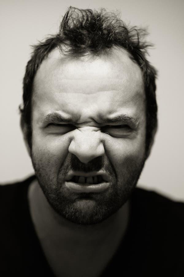 Angry man grimacing royalty free stock photos