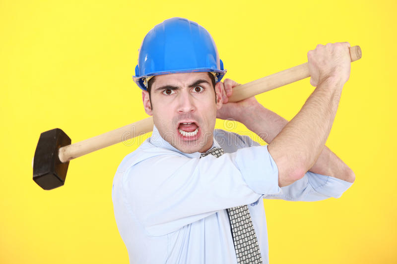 Angry Man With Hammer Royalty Free Stock Photography