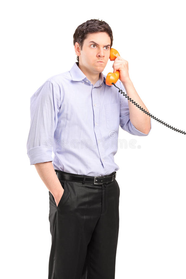 Angry Man Having A Telephone Conversation Stock Photography