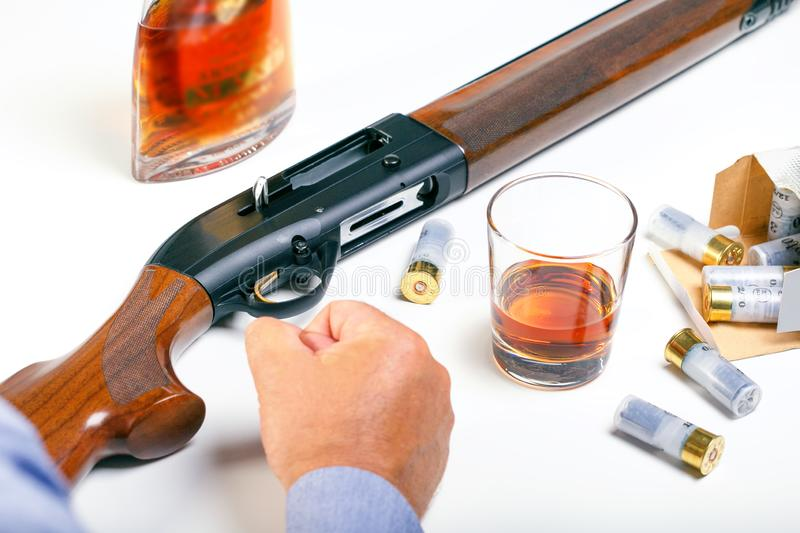 Angry man holding a rifle. Man With Rifle. And alcohol royalty free stock image